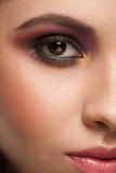 Woman with makeup. Closeup half face portrait of attractive young woman with bright makeup Royalty Free Stock Photography