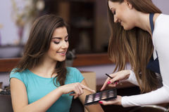 Woman with makeup artist Stock Images