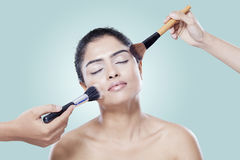 Woman with makeup artist hands Stock Photography