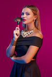 Woman makeup artist standing with brush Royalty Free Stock Images