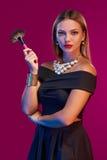 Woman makeup artist standing with brush Stock Photos