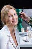 Woman at makeup artist Royalty Free Stock Photography