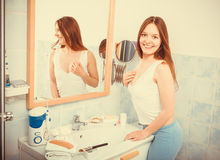 Woman without makeup in bathroom. Happy young girl woman without makeup in bathroom standing in front of mirror smiling. Natural beauty. Purity. Instagram stock image