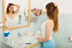 Woman without makeup in bathroom. Stock Photos
