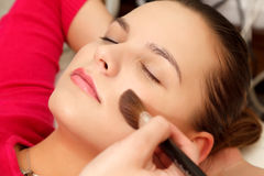 Woman with makeup brush Stock Photos
