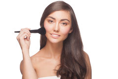 Woman with makeup brush Royalty Free Stock Image