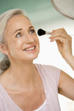 Woman with makeup brush Stock Photo