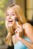 Woman with makeup brush Royalty Free Stock Photos