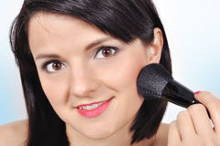 Woman with makeup brush Royalty Free Stock Photos