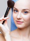 Woman with makeup brush Royalty Free Stock Images