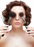 Woman with makeup brush Stock Images