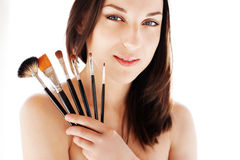 Woman with makeup brushes Royalty Free Stock Images