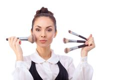 Woman with makeup brushes.  All isolated on white Royalty Free Stock Images