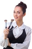 Woman with makeup brushes.  All isolated on white Stock Photos