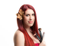Woman with makeup brushes Stock Photos