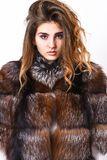 Woman makeup calm face hair volume hairstyle. Winter hair care tips you should follow. Hair care concept. Girl fur coat. Posing with hairstyle on white stock images