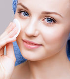 Woman with makeup cotton pad Royalty Free Stock Image