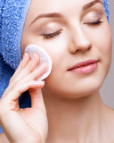Woman with makeup cotton pad Royalty Free Stock Images