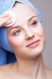 Woman with makeup cotton pad Royalty Free Stock Photos
