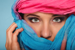 Woman makeup on eyes hiden her face with shawl Stock Photo