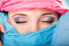 Woman makeup on eyes hiden her face with shawl Royalty Free Stock Images