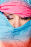 Woman makeup on eyes hiden her face with shawl Royalty Free Stock Photos