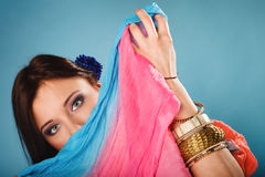 Woman makeup on eyes hiden her face with shawl Stock Photography