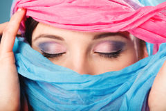 Woman makeup on eyes hiden her face with shawl Royalty Free Stock Photo