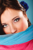 Woman makeup on eyes hiden her face with shawl Stock Image