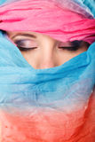 Woman makeup on eyes hiden her face with shawl Royalty Free Stock Image