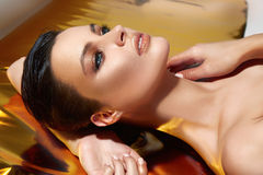Woman makeup gold fashion style cosmetic care skin Royalty Free Stock Image