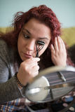 Woman makeup at home. Stock Photography