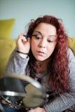 Woman makeup at home. Stock Photos