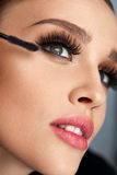 Woman With Makeup, Long Eyelashes Applying Mascara. Doing Makeup Royalty Free Stock Images