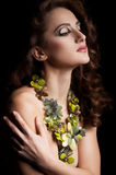 Woman with makeup in luxury green necklace Stock Photography