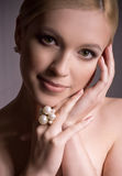 Woman with makeup in luxury jewelry Stock Photography