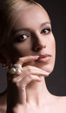 Woman with makeup in luxury jewelry Royalty Free Stock Photography