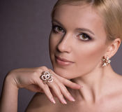 Woman with makeup in luxury jewelry Stock Image