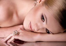 Woman with makeup in luxury jewelry Royalty Free Stock Photo