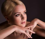 Woman with makeup in luxury jewelry Royalty Free Stock Image