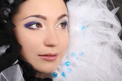 Woman with makeup and material Stock Images