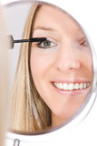 Woman makeup in mirror. Reflection on isolated background Stock Images