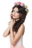 Woman with Makeup, Permed Hair and Flowers Isolated on. Gorgeous Woman with Makeup, Permed Hair and Flowers Isolated on White Background Stock Photography