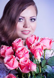 Woman with makeup and pink roses Royalty Free Stock Images