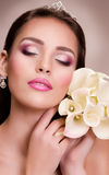 Woman with makeup and precious decorations Stock Image