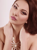 Woman with makeup and precious decorations Stock Photo