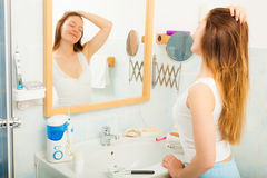 Woman without makeup relaxing in bathroom. Royalty Free Stock Photo
