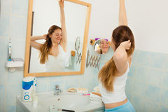 Woman without makeup relaxing in bathroom. Royalty Free Stock Images