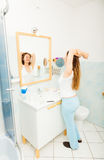 Woman without makeup relaxing in bathroom. Royalty Free Stock Image
