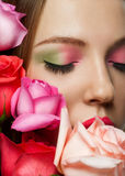 Woman with makeup and roses Stock Photography